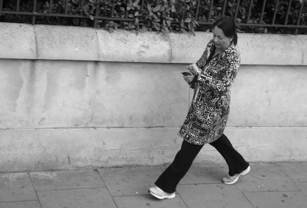 Checking the time. Mile End Road. East London 2010.