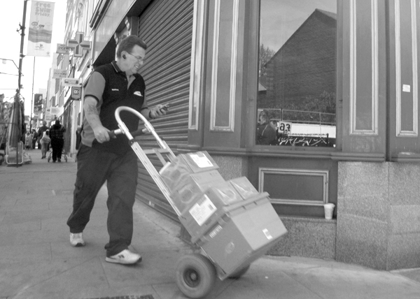 Delivering. Roman Road, east London 2010.