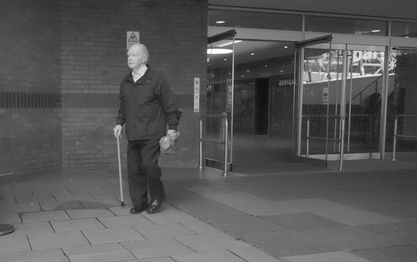 Man with a walking stick. St John's shopping mall. Liverpool 2017.