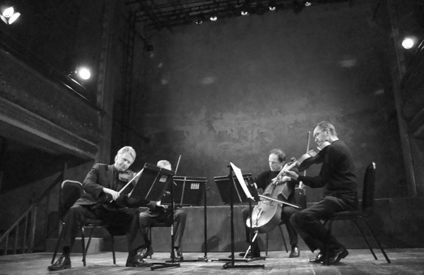 The Smith Quartet rehearsing at Wilton's Music Hall for Deirdre Gribbin's opera 'Crossing The Sea. East London 2010.