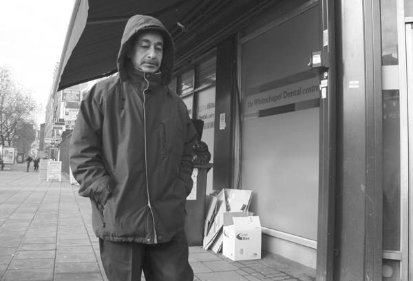 Man in a hood. Whitechapel Road. East London 2010.