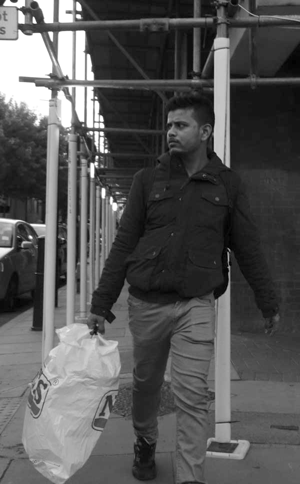 Man with a bag in Old Montague Street. East London September 2017.
