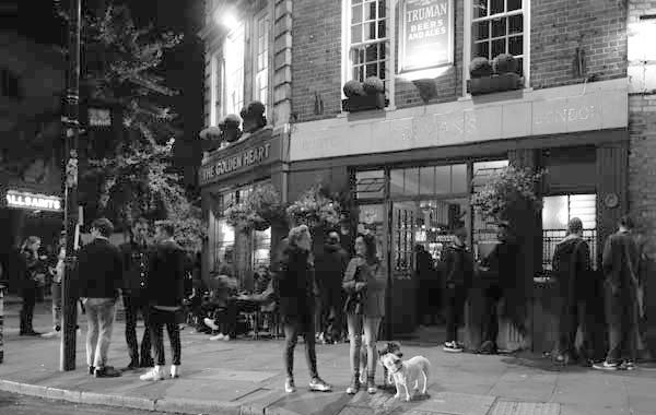 Outside the 'Golden heart' pub. Spitalfields. East London September 2017.