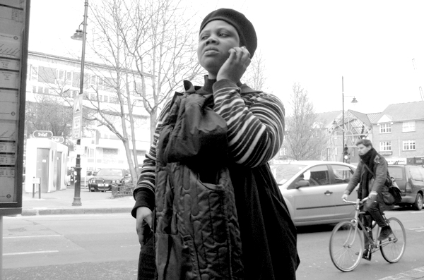 On the phone. Roman Road. East London, March 2010.