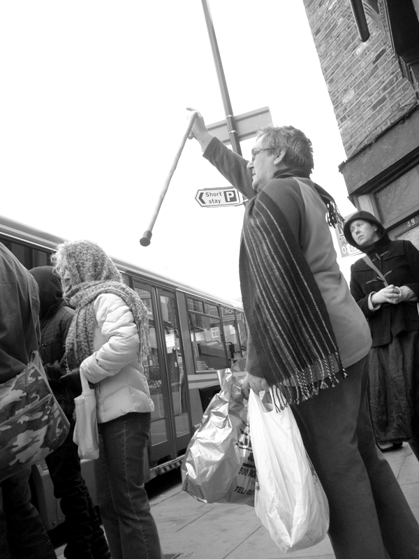 Bus stop on the Roman Road. East London, March 2010.