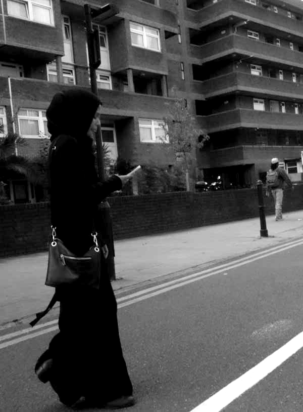 On the phone in Hanbury Street. East London September 2017.