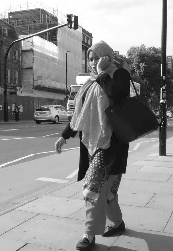 On the phone in Whitechapel. East London September 2017.