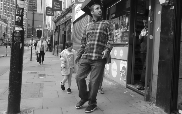 Leaving a shop. Whitechapel High Street. East London 2017.