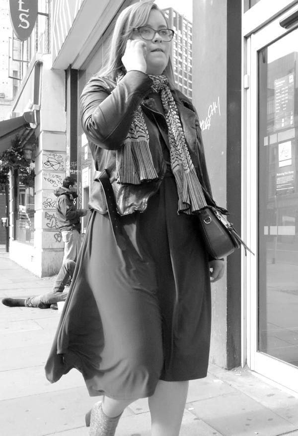 On the phone. Whitechapel High Road. East London 2017.