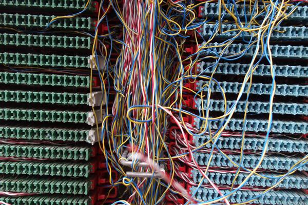 Exposed telephone wires in Hanbury Street. East London 2017.