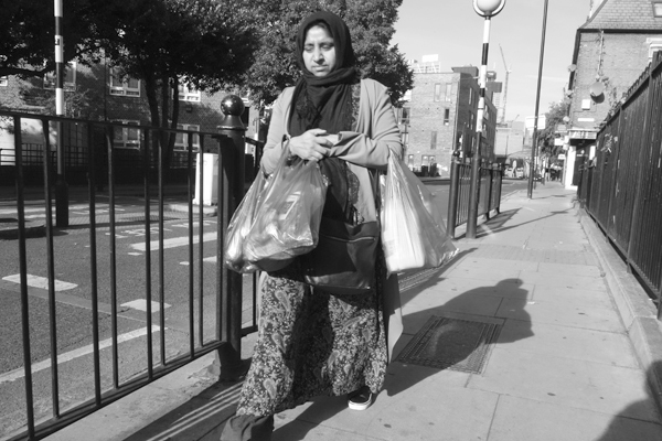 Woman with shopping on Hanbury Street. East London 2017.