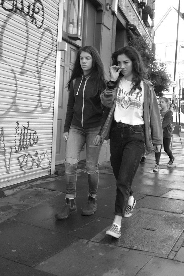 Two girls walking towards Brick Lane. Hanbury street. East London 2017.