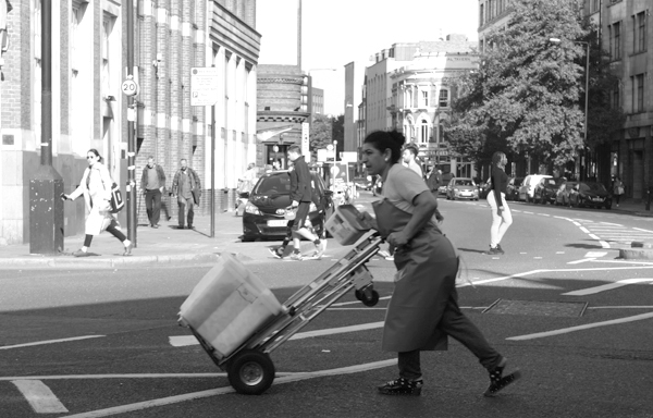 Pushing a trolley. Commercial Street. East London 2017.
