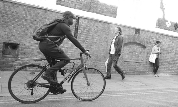Cyclist on Brick Lane. East London 2017.
