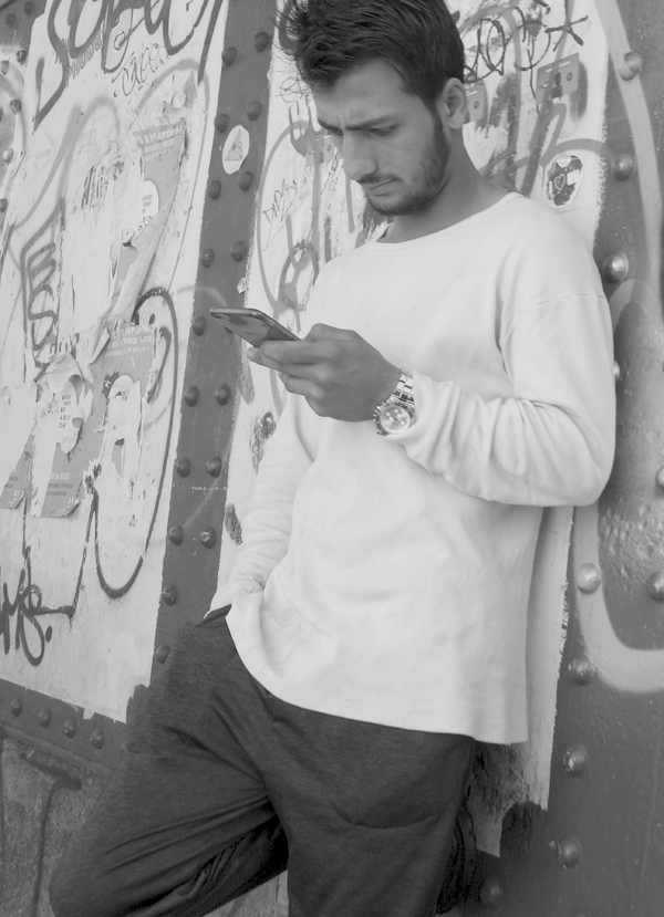 On the phone. Brick Lane. East London 2017.