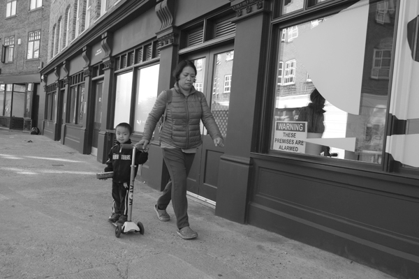 Woman & child with a scooter. Cheshire Street. East London 2017.