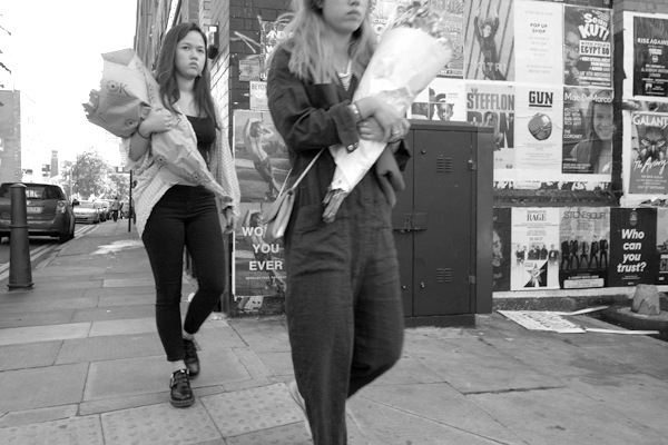 Young women with flowers on on Cheshire Street. East London 2017.
