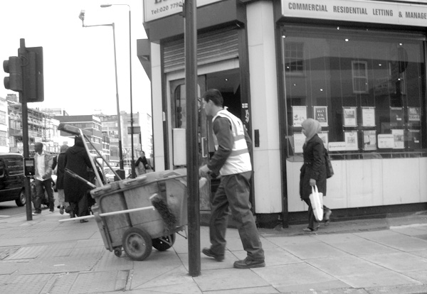 Street cleaner on Commercial Street. East London, May 2010.