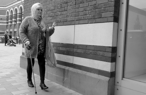 Woman with a walking stick. Liverpool October 2017.