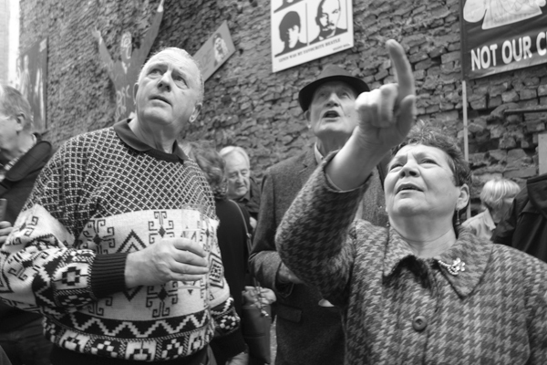 Members of the Merseyside Pensioners Association (who helped to sponsor Red October) discuss the art works. Temple Street Liverpool 2017.
