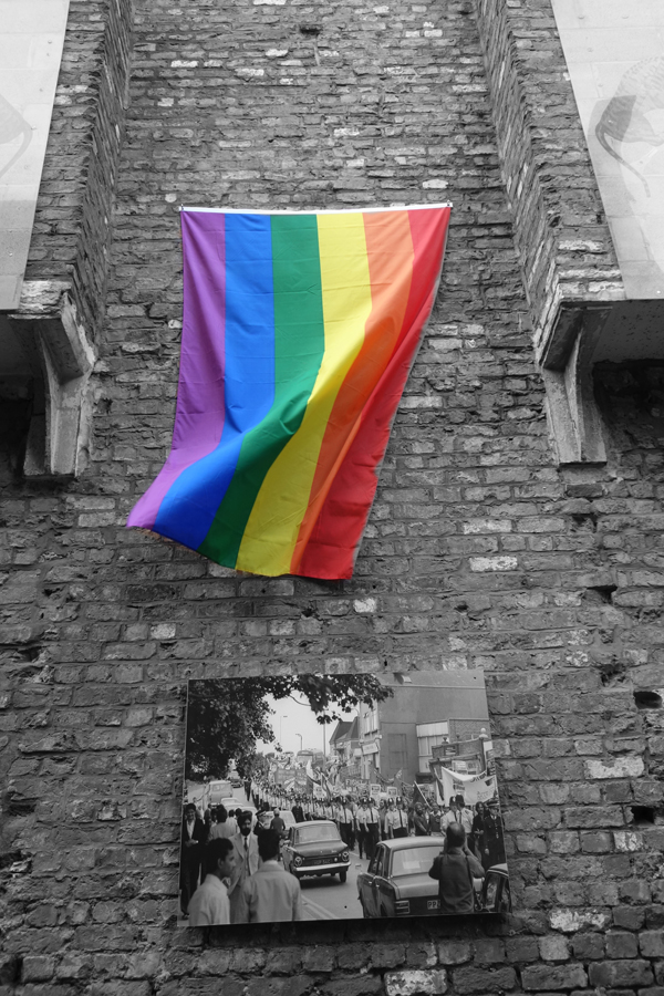 The rainbow flag with a photograph by Ian Woods. Temple Street Liverpool 2017.