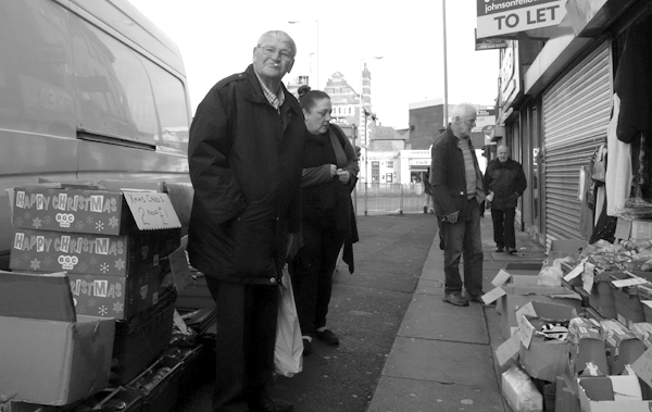Bargains on the street in Old Swan. November, Liverpool 2017.
