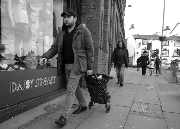 Man with a shopping trolley in Old Swan. November, Liverpool 2017.