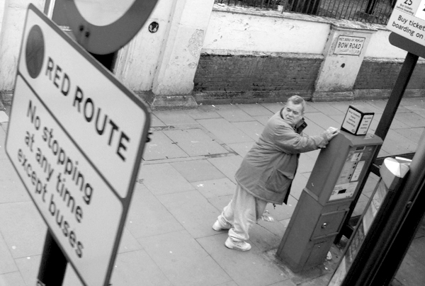 Looking for a bus. Mile End Road. East London 2010.