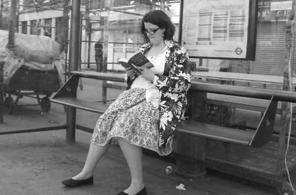 Bus stop read on Whitechapel Road. East London, June 2007.
