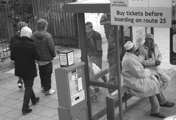 Bus stop. Mile End Road. East London 2010.