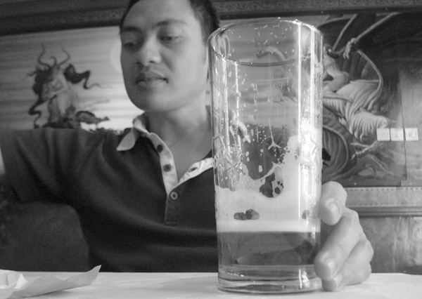 Finishing a pint in Cafe Bangla on Brick Lane. East London, June 2007.