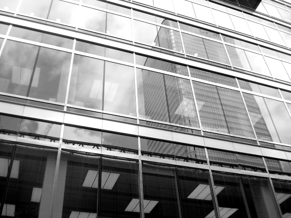 Reflections. View from the top of a bus. Canary Wharf, East London, June 2007.