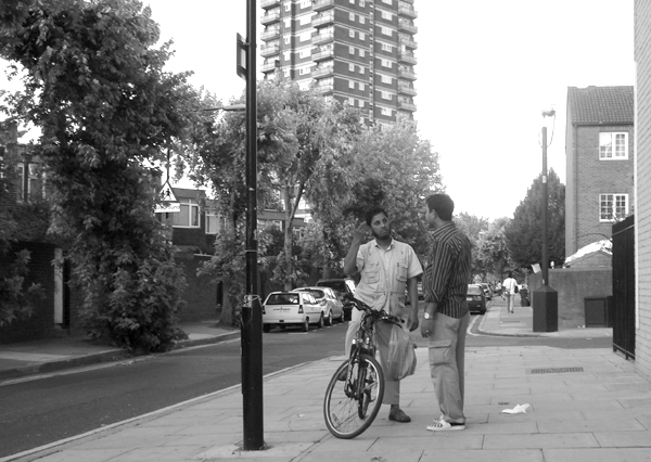 Conversation on Hanbury Street. East London August 2008.