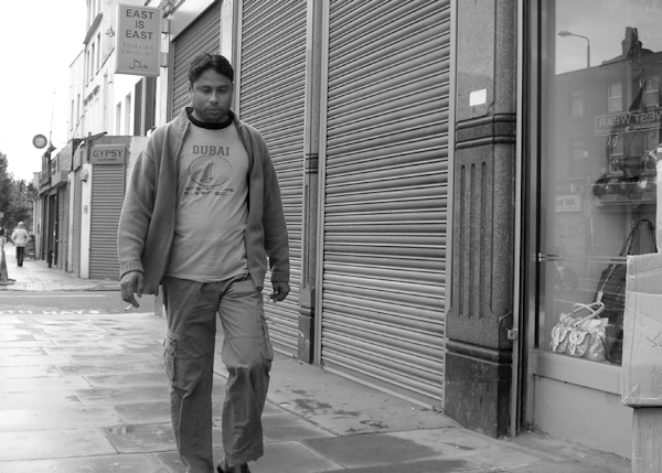 Man with a cigarette on Commercial Road. East London August 2008.