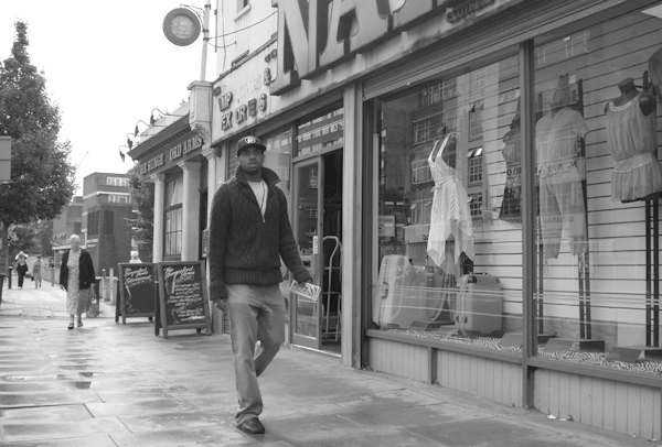 Man with a cap. Commercial Road. East London August 2008.