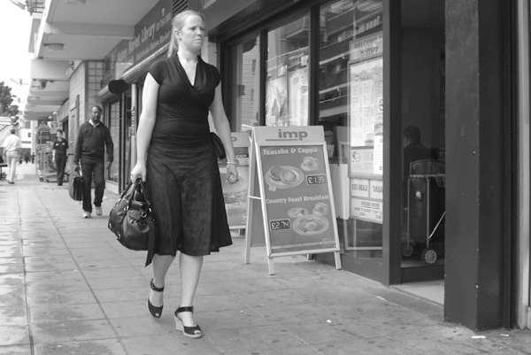 Passing a cafe in Watney market. East London August 2008.