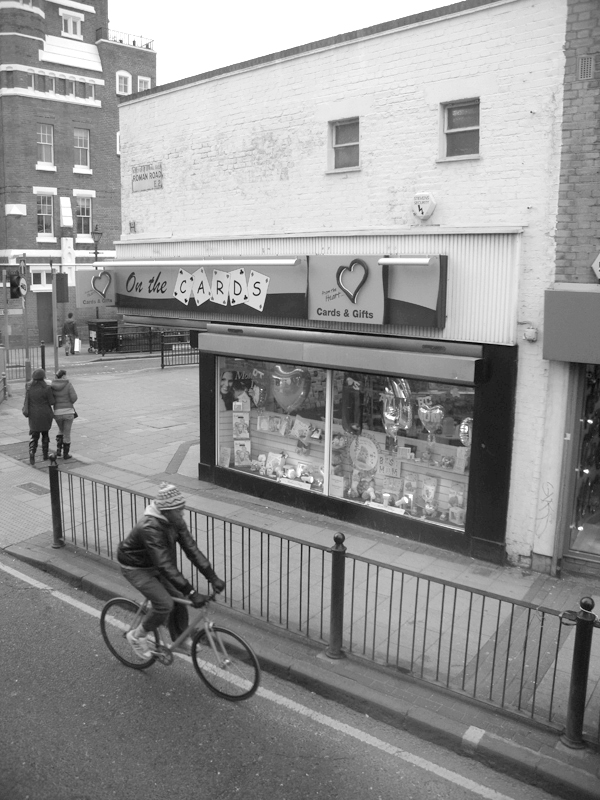 Man on a bike. Roman Road. East London 2010.