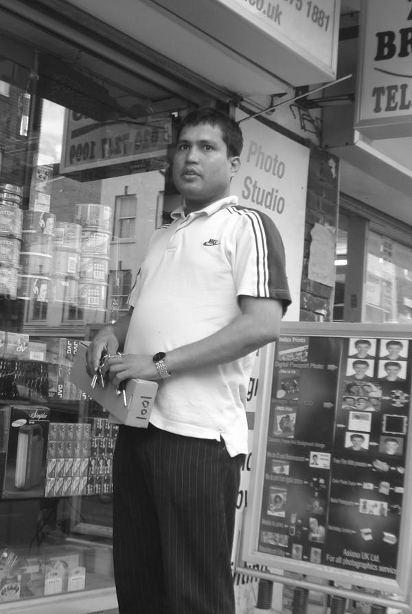 Outside a photo studio on Brick Lane. East London, June 2007.