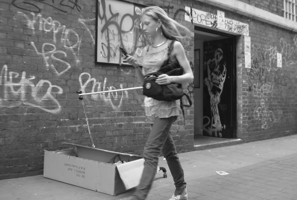 On the phone in Brick Lane. East London, June 2007.