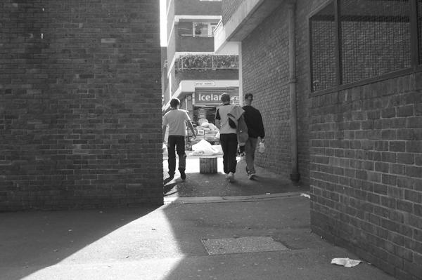 Walking into Watney market. East London August 2008.