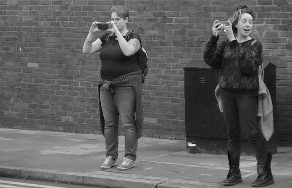 Street Art tourists on Brick Lane. East London 2017.