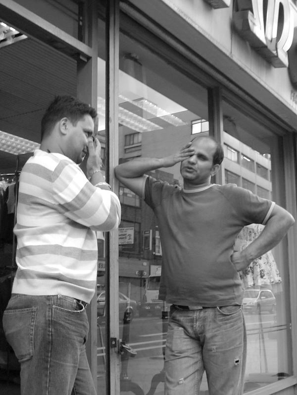 Conversation on Commercial Road. East London August 2008.