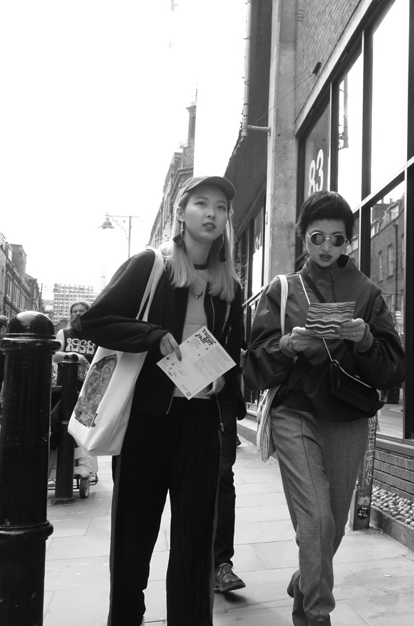 Tourists in Brick Lane. East London 2017.