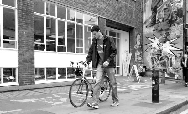 Cyclist in Hanbury Street. East London 2017.