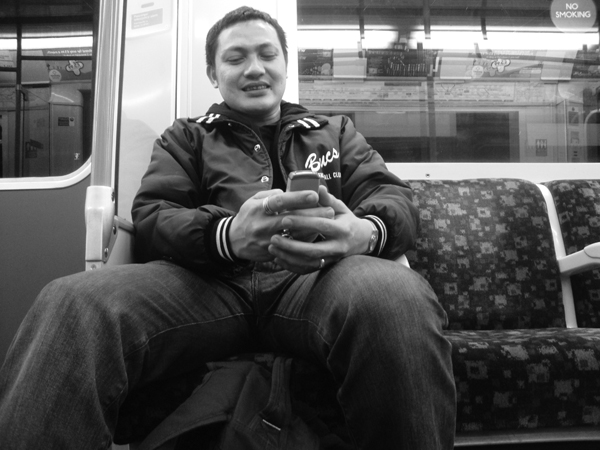 Hazuan on the phone, Whitechapel station. East London, April 2010.