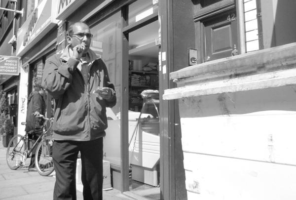 Smoking on Brick Lane. East London May 2010.