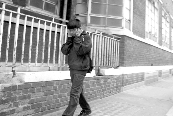 On the phone in Mew Road. East London May 2010.