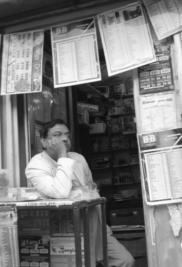 Kiosk selling phone cards & lighters. Whitechapel Road. East London, June 2007.