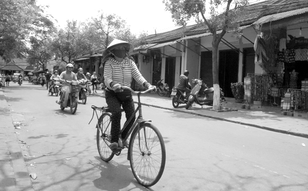 Woman on a bike. Hoi An, Vietnam 2016.