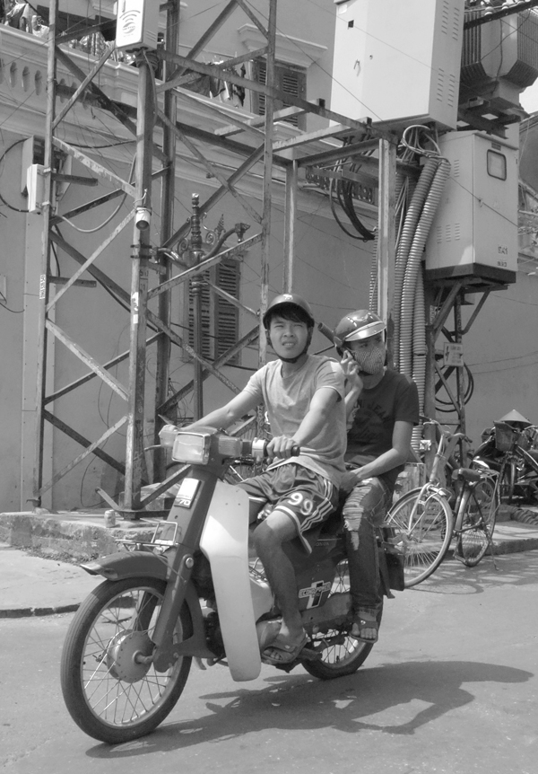 Sharing a moped. Hoi An, Vietnam 2016.